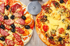 Two big hot and tasty pizzas Stock Images