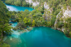 Two big lakes seperated with small waterfalls in Plitvice Lakes. Green lake between big canyon located in Plitvice National Park Royalty Free Stock Photos