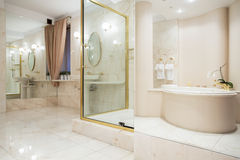 Two big mirrors. In enormous luxury bathroom stock photography
