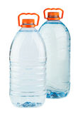 Two big plastic water bottles with orange caps Royalty Free Stock Photo