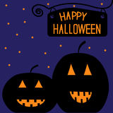 Two big pumpkins at night. Happy Halloween card. Royalty Free Stock Photography