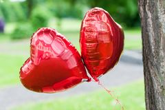 Two big red balloons with hearth shape stock images