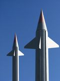 Two big rockets. With clear blue sky background Royalty Free Stock Photography