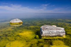 Two big rocks. A photo of two big stones in the blooming sea on a bright sunny day Royalty Free Stock Photos