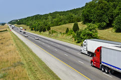 Two Big Semi Trucks On Highway Stock Image
