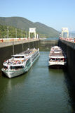 Two big ships in locks. Two big passenger river cruises ships passing through the locks of Iron Gates on Danube Stock Photography