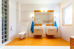 Two big sinks and mirror at family bathroom Royalty Free Stock Photography