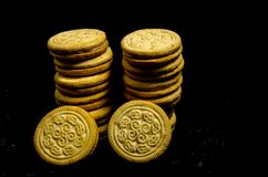 Two big stack`s of sweet round cookie`s. A cookie is a baked or cooked food that is small, flat and sweet. It usually contains flour, sugar and some type of oil Royalty Free Stock Photo