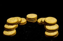Two big stack`s of sweet round cookie`s. A cookie is a baked or cooked food that is small, flat and sweet. It usually contains flour, sugar and some type of oil Stock Photos