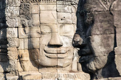 Two Big stone faces. Big stone faces in Angkor wat in Cambodia Royalty Free Stock Images
