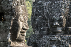 Two Big stone faces in the rock. Big stone faces in Angkor wat in Cambodia Royalty Free Stock Photo