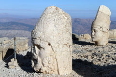 Two heads. Two big stone heads on the mount Nemrud in Turkey Royalty Free Stock Images