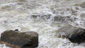 Two big stones in the waves. Two rocks in the sea waves stock video