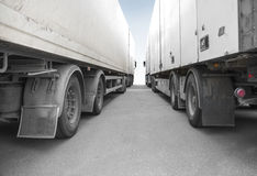 Two big trucks. Low angle view of two big trucks on asphalt Stock Photo