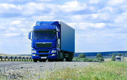 Two big trucks move on highway Stock Image