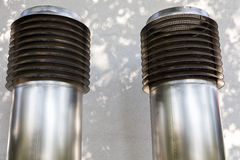 Two big ventilation pipes Stock Photos