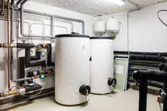 Two big white boiler and heating net royalty free stock photos