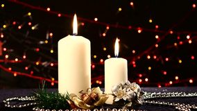 Two big white candles with christmas decorations stock video footage