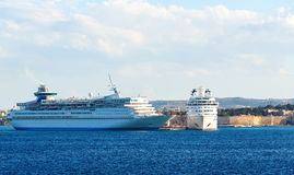 Two big white cruise ships in port of island of Rhodes, Greece. Big white cruise ship in the port of the island of Rhodes Greece Stock Photography