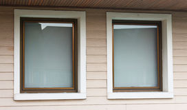 Two big windows on the wood pattern wall Royalty Free Stock Images