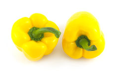 Two big yellow bell peppers isolated closeup Stock Photos