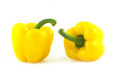 Two big yellow peppers isolated closeup Stock Images