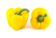 Two big yellow peppers isolated closeup Stock Photography