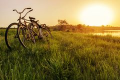 Free Two Bike Near The Lake Sunset Background. Two Vintage Bicycles At Sunset. The Concept Of Romance And Love Stock Image - 121285461