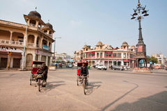 Two bike rickshaw compete in speed on the wide street Stock Photos