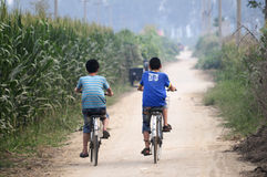 Two bike-riding boys Stock Photo