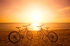 Two bike silhouette at the sunset near sea stock image