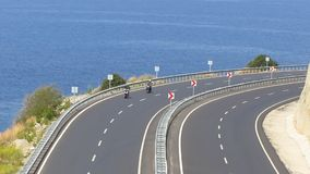 Two biker. S on the road along the sea in Turkey stock video footage
