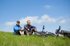 Two bikers. In the park Royalty Free Stock Photos