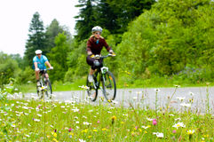 Two bikers. Relax biking in forest Stock Photo