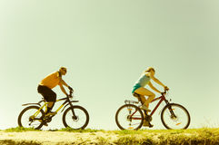 Two bikers. Relax biking on road Stock Images
