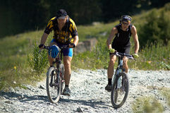 Two bikers on high mountain road Royalty Free Stock Photo