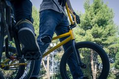Two bikers with his bicycles stock images