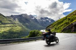 Two bikers in motion. Bikers who ride along the beautiful grossglockner high alpine road Royalty Free Stock Images