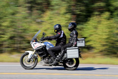 Two Bikers Riding a Motorcycle, motion blur Stock Photos