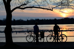 Two bikers at sunset Royalty Free Stock Image