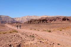 Two bikers in Timna mountains. Two unrecognized mountain bikers cycling in the desert, Timna National park in Israel Stock Images