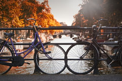 Two bikes in Amsterdam. Two bikes on a bridge over a canal in Amsterdam, Netherlands (in the neightborhood called Jordaan stock photos