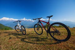 Two bikes. On the background of the Himalayan mountains stock photos