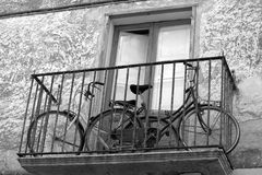 Two bikes on a balcony. Two bicycles parked on a balcony of the house Royalty Free Stock Photos
