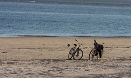 Two Bikes and Ball on Beach Stock Photography