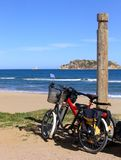 Two bikes on the beach. In Estartit (Costa Brava, Spain) with Medes Islands on background Stock Photo