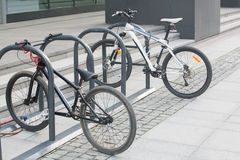 Two bikes on the Bicycle parking Stock Photography