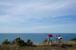 Two bikes by the coast Stock Photography