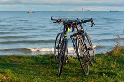 Two bikes on the beach, two bikes on the coast Stock Photo