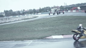 Two bikes coming into a corner on the test race stock video footage
